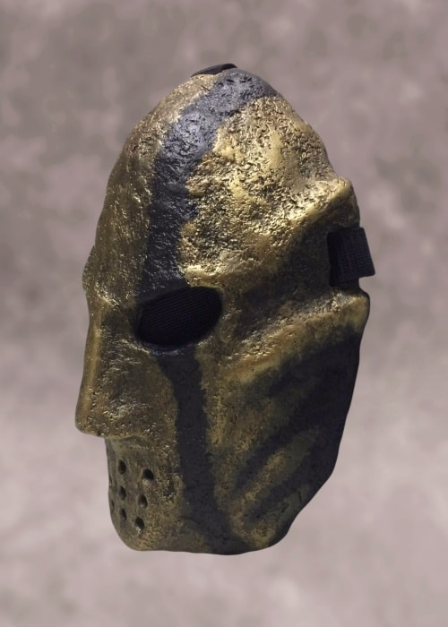Left front view of mask. Its rough texture is clearly visible.