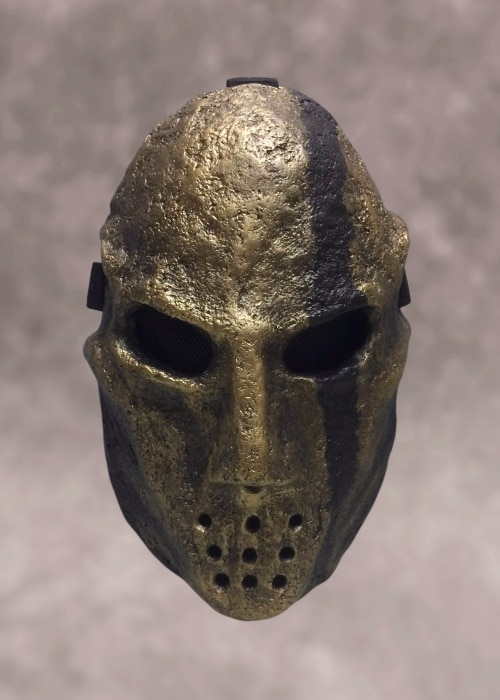 Stern, dark bronze mask with a black line running down its forehead, left eye, and cheek.