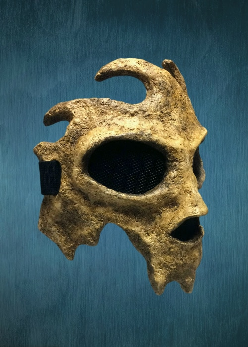 "Right front of mask. There is a larger spur of ""bone"" behind the cheek where the jaw would begin."