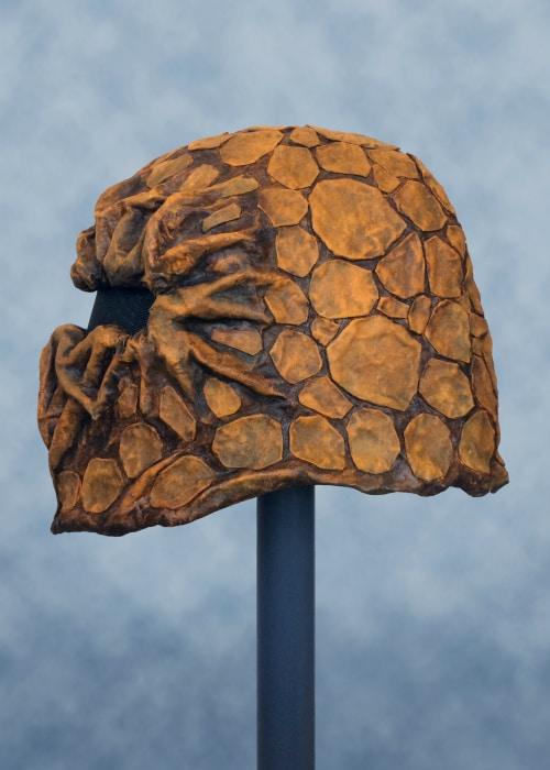 Left side of mask. Its helmet shape is apparent.