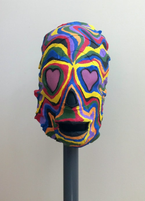 Front of mask. It has pink hearts for eyes.
