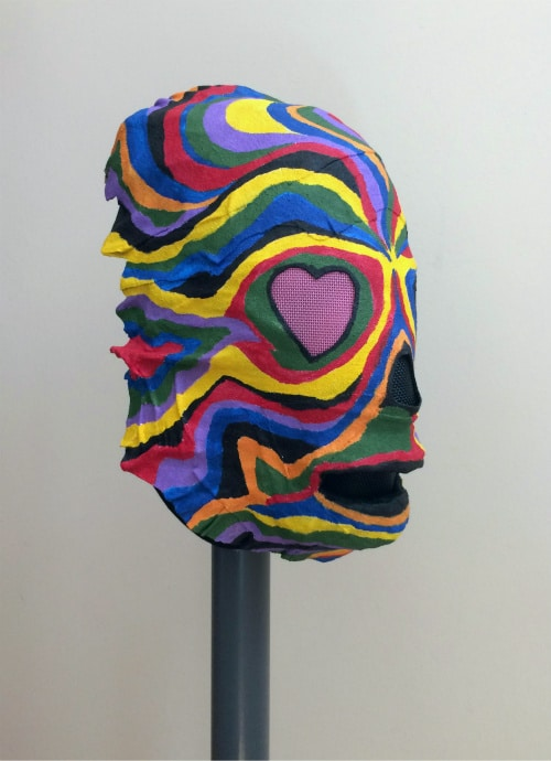 Right front view of mask painted with wavy colorful lines.