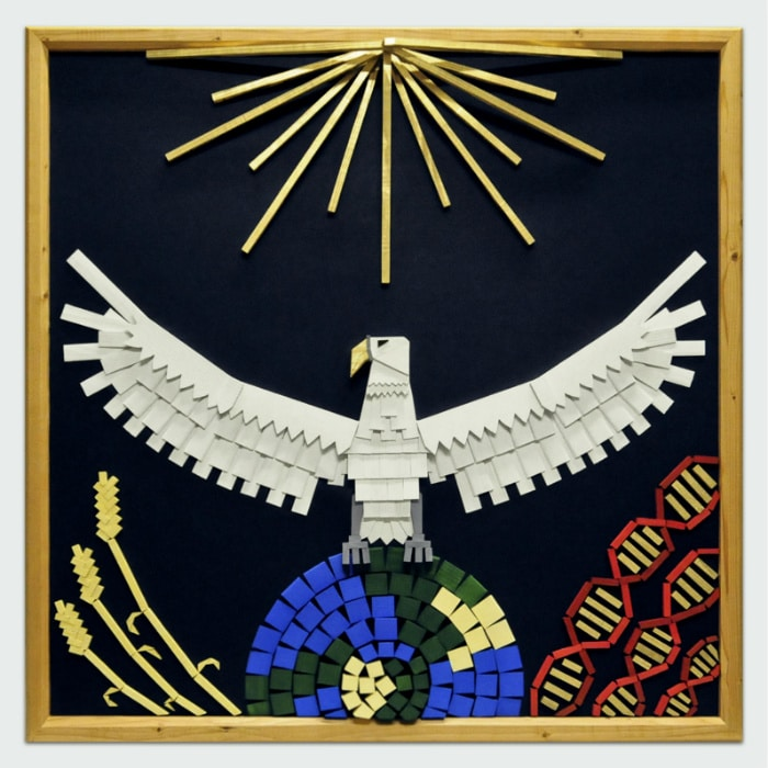 White bird with golden beak and outstretched wings sitting atop planet. Beneath one wing there are three strands of DNA, beneath the other, three stalks of wheat. Golden rays of sun from above. On dark blue background within wooden frame.