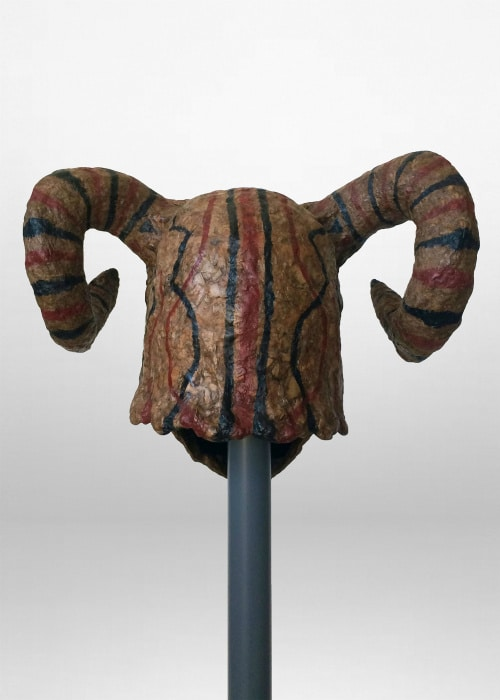 Back view. The back of the mask is painted with patterns of red and black lines.